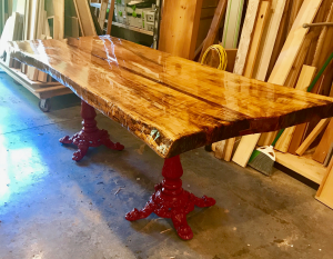 Live edge table made from a maple tree in the valley about 8' long and 3' wide and 3 inch thick.